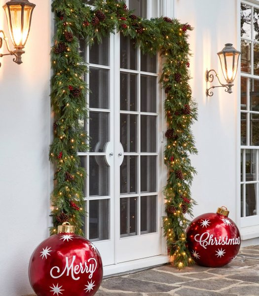 Balsam Hill Winter Evergreen Garland and oversized Christmas ornament outside French doors