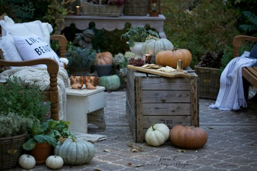 Pumpkins on top of a wooden box used a makeshift table