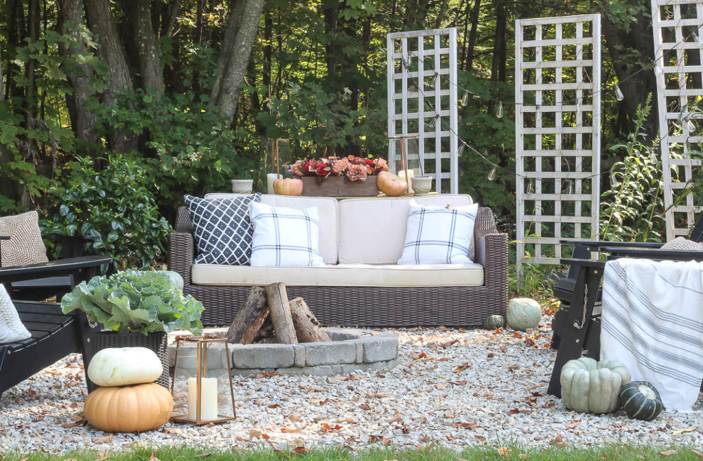 Outdoor sofa arranged around a fire pit