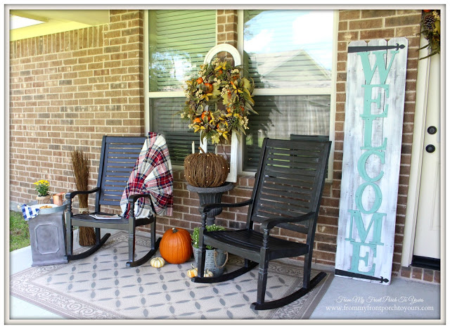 Front porch with autumn foliage and rocking chairs