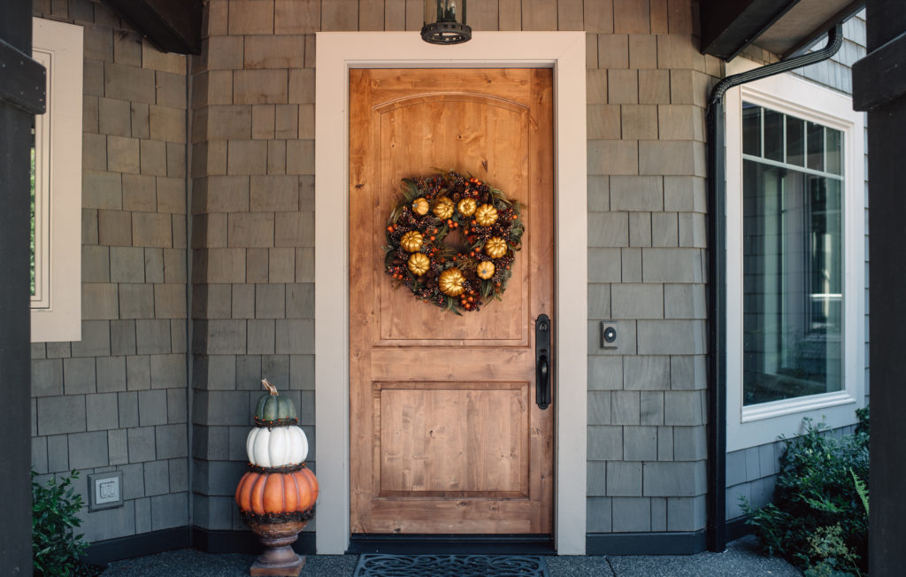 Front door with Balsam Hill Autumn Bounty Artificial Wreath and Outdoor Heirloom Pumpkins