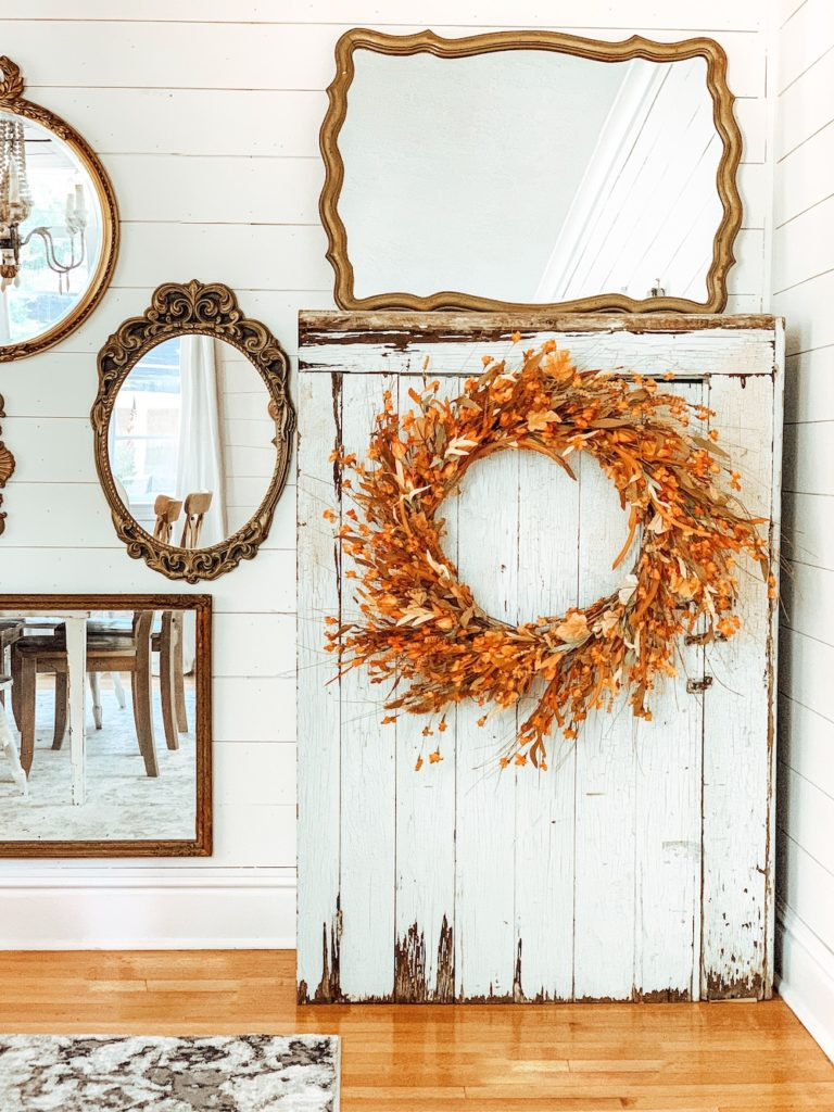 Balsam Hill Sunset Meadow Artificial Fall Wreath on a cabinet
