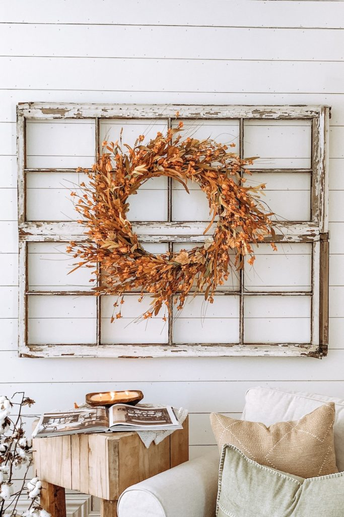 Balsam Hill's Sunset Meadow Artificial Fall Wreath in a window frame