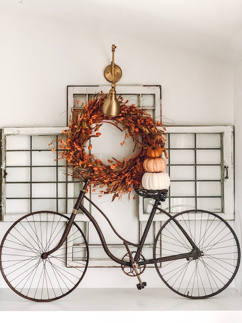 Balsam Hill Sunset Meadow Artificial Fall Wreath on statement wall