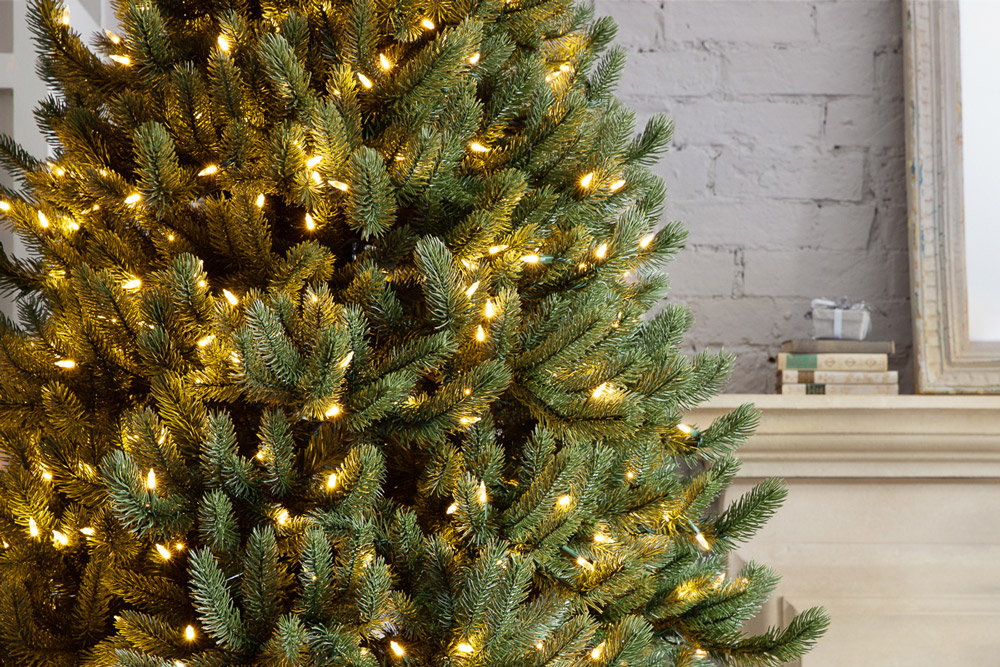 close-up artificial Christmas tree with clear lights