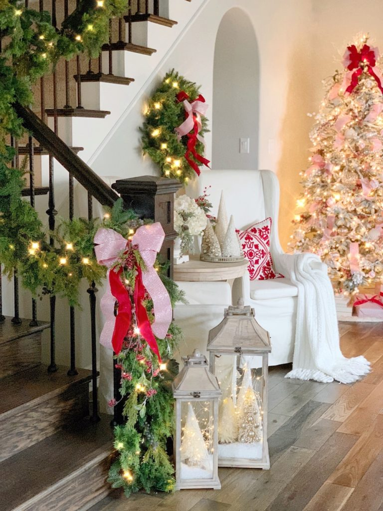 Staircase decorated with holiday garland and ribbon
