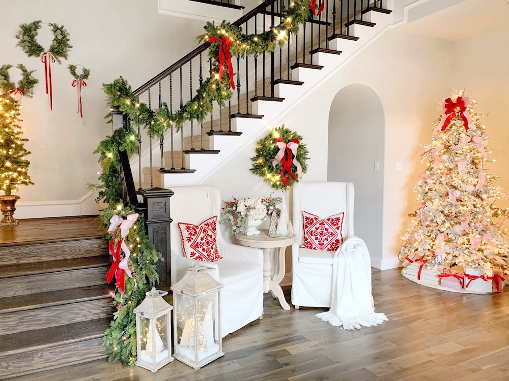 Staircase decorated with artificial Juniper garland and wreath