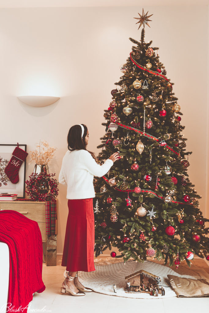 Burgundy and gold Christmas tree theme ideas for homes with high ceilings