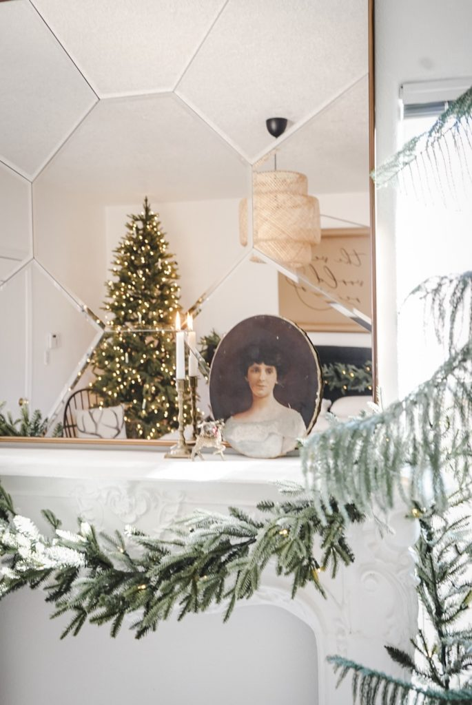 Balsam Hill Fraser Fir garland with a picture frame, candle, and mirror as spring mantel décor ideas