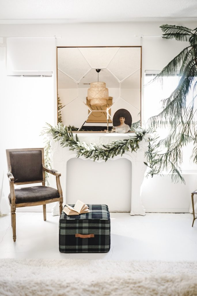White room with Balsam Hill Fraser Fir Garland as fireplace mantel décor