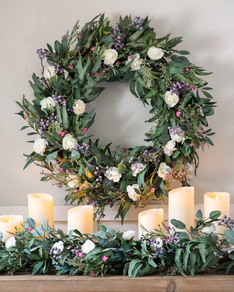 Ranunculus and Waxflower floral wreath and garland with LED pillar candles as spring mantel ideas