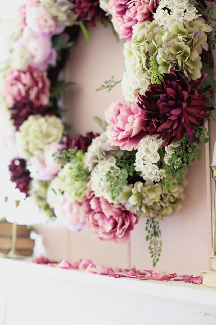 Purple Peony flower wreath on blush pink wall as mantel décor ideas