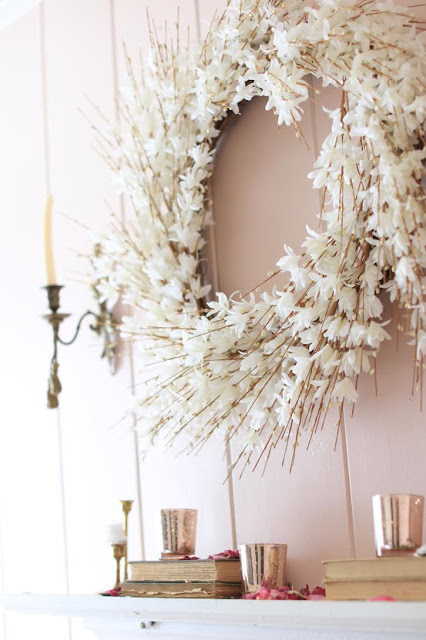 White Forsythia Wreath and blush pink wall as spring décor