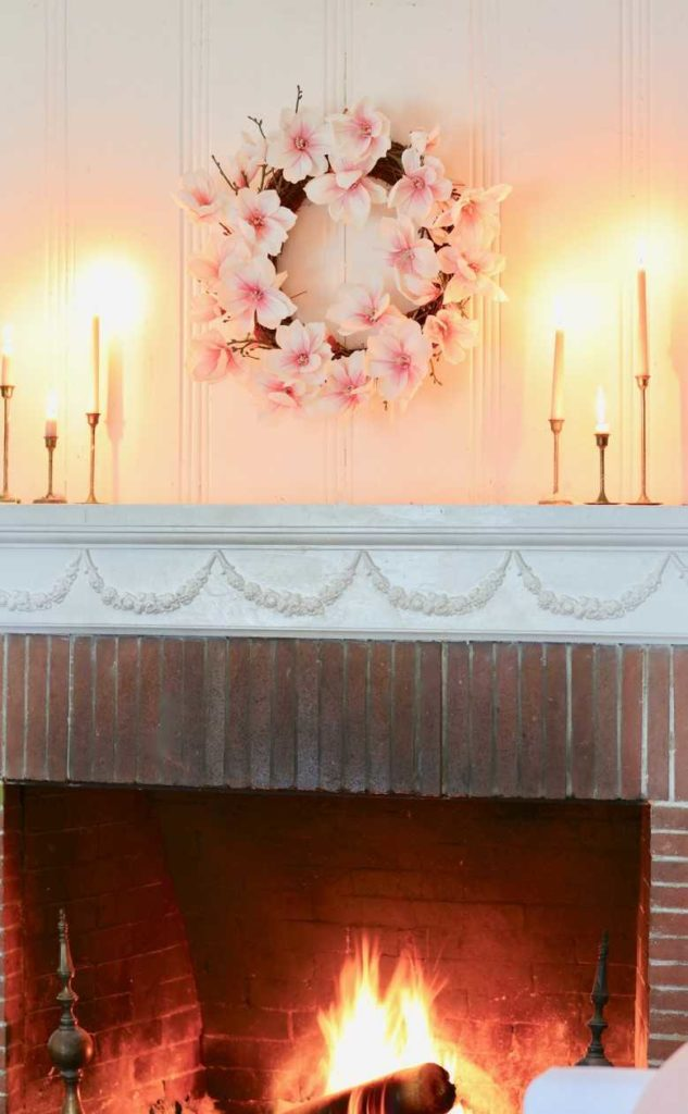 Japanese Magnolia Wreath with taper candles as fireplace mantel décor