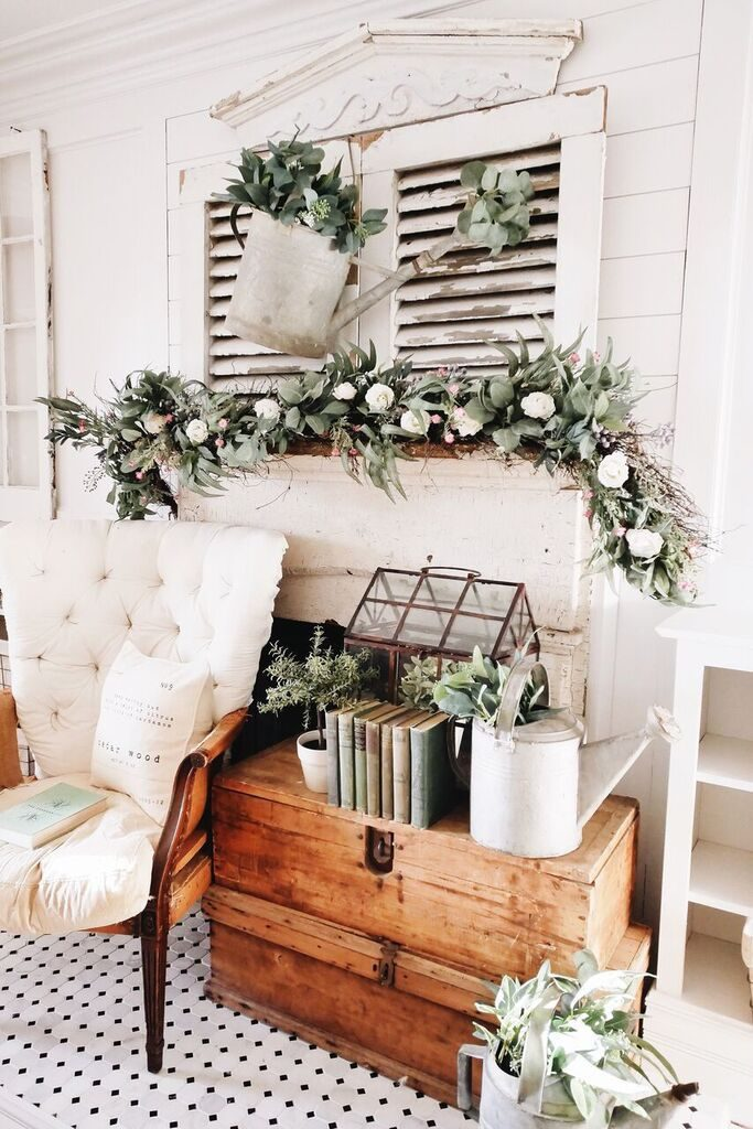 Distressed wood shutters decorated with Ranunculus and waxflower garland and foliage on watering can as easter mantel ideas
