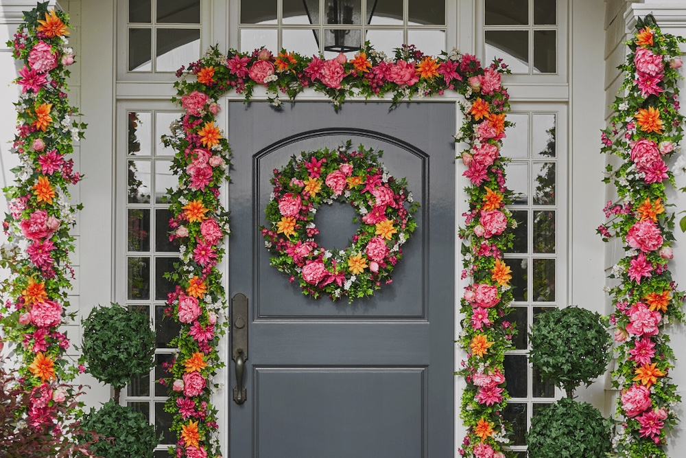 colorful floral wreath, garlands and topiaries on porch