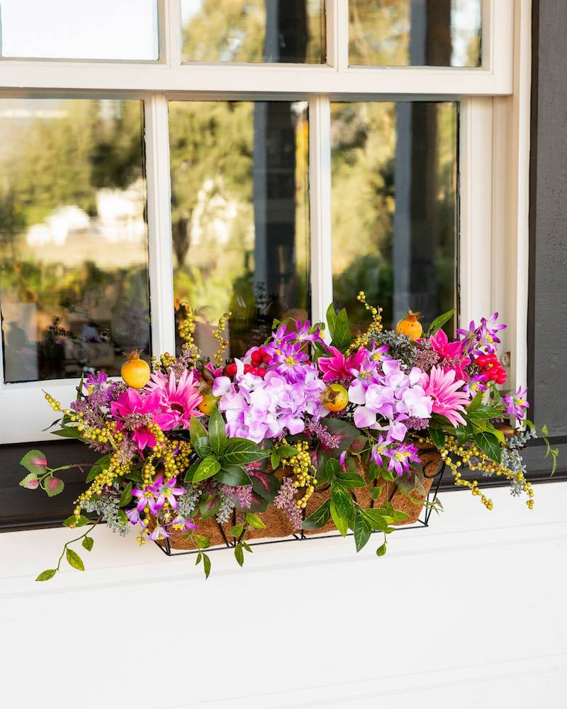 purple summer flowers in window basket