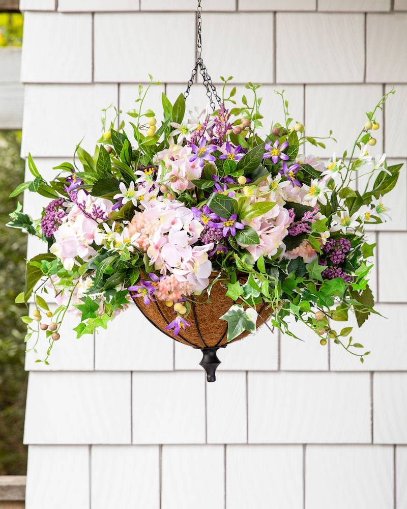 lavender artificial flowers in a hanging basket