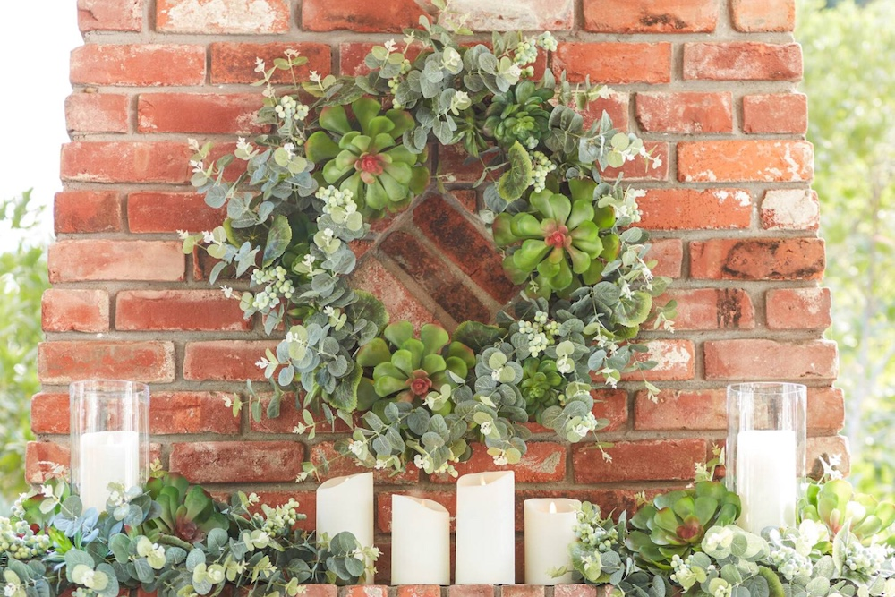 succulent wreath and garland on brick mantel