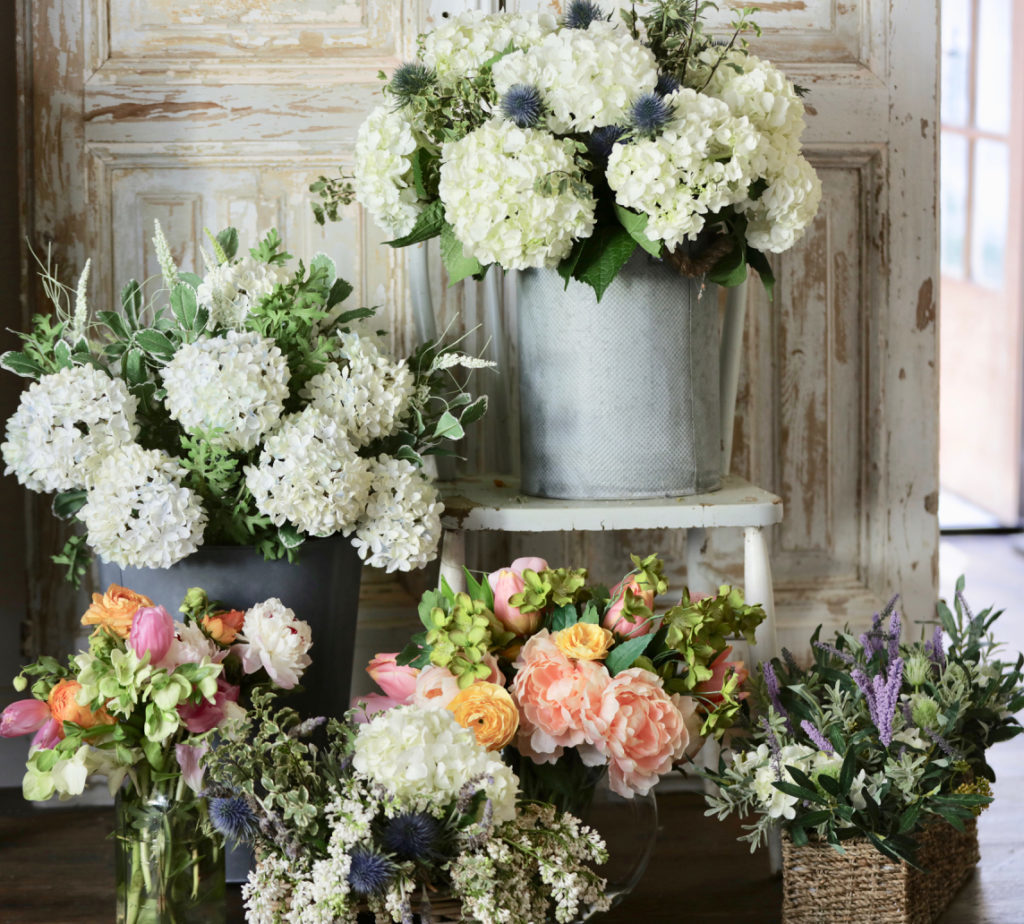 Real vs artificial floral arrangements in various vessels