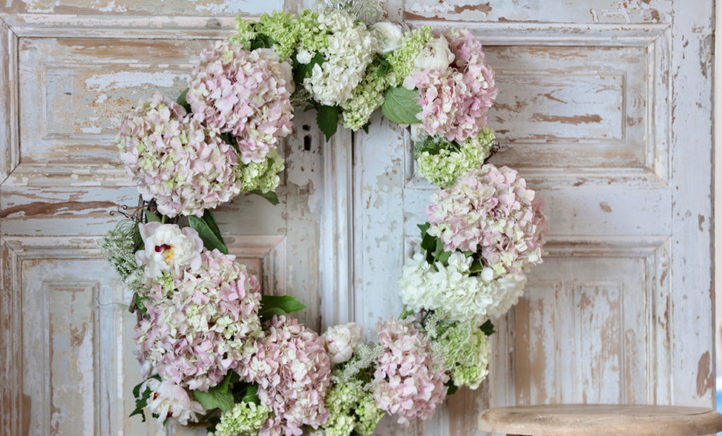 Wreath with fresh hydrangeas in pink and green, peonies, Queen Anne's Lace, and maidenhair fern