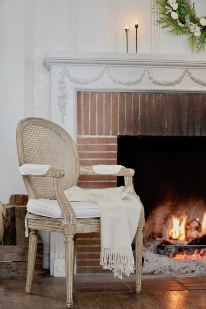 Garnet Hill Brushed Cotton Throw set in a chair by the fireplace