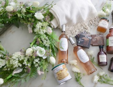 Balsam Hill floral wreath, Stonewall Kitchen Brunch Gift Basket, Olema Côtes de Provence Rosé Wines, Tcho Chocolates, and Garnet Hill Cotton Throw are some of the best Mother's Day gift ideas
