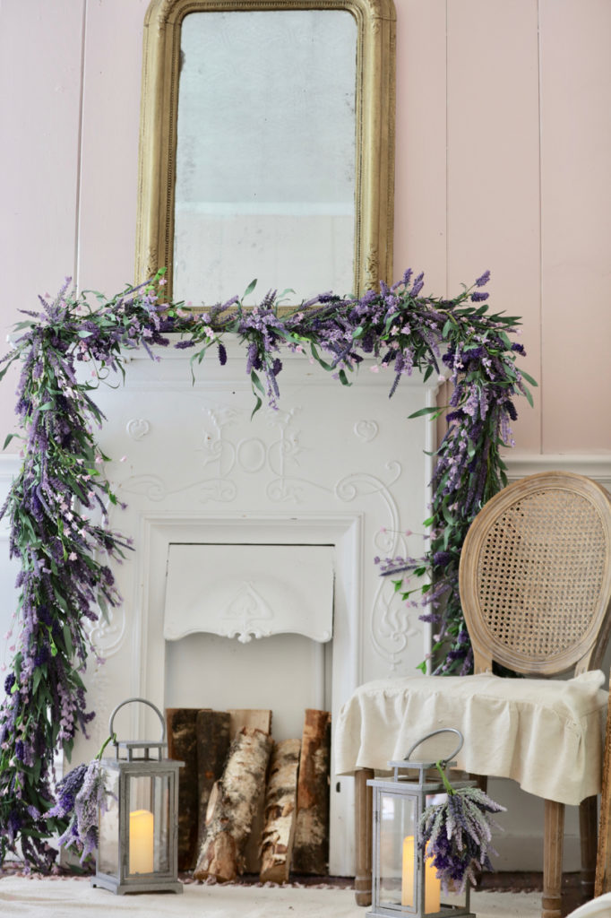 Fireplace mantel decorated with artificial lavender