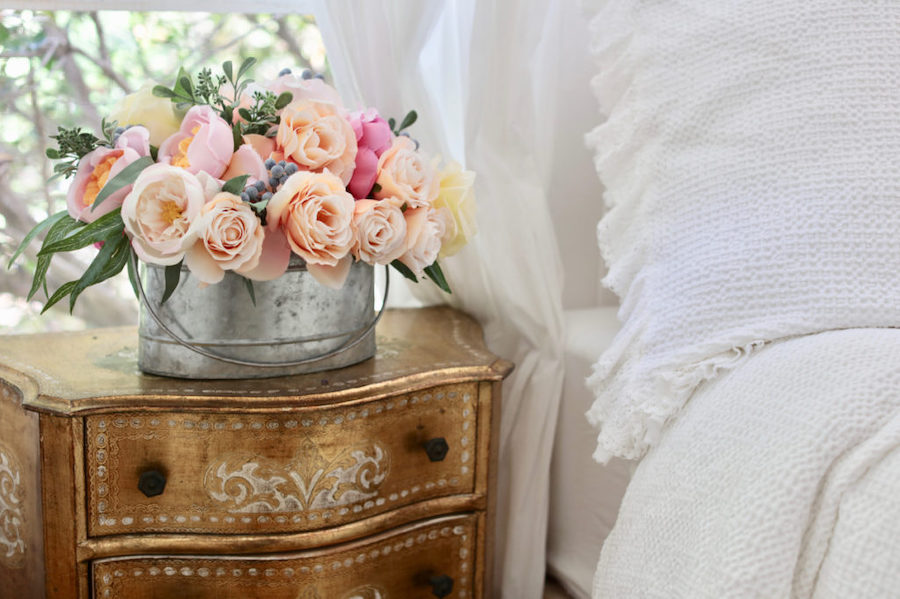 Artificial garden roses in galvanized container