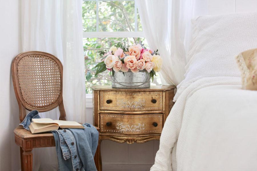 Colorful faux garden roses arrangement as room décor in bedroom