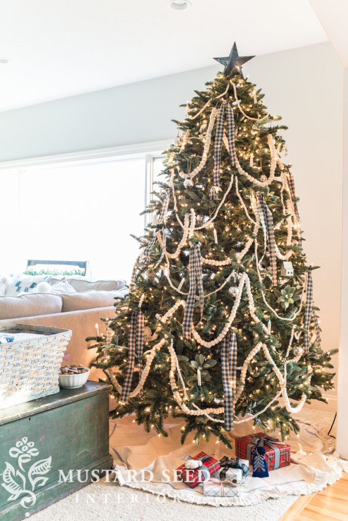 Artificial Christmas tree decorated with traditional country theme