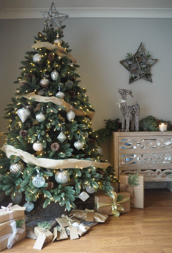 full shot of christmas tree decorated with french country ornaments