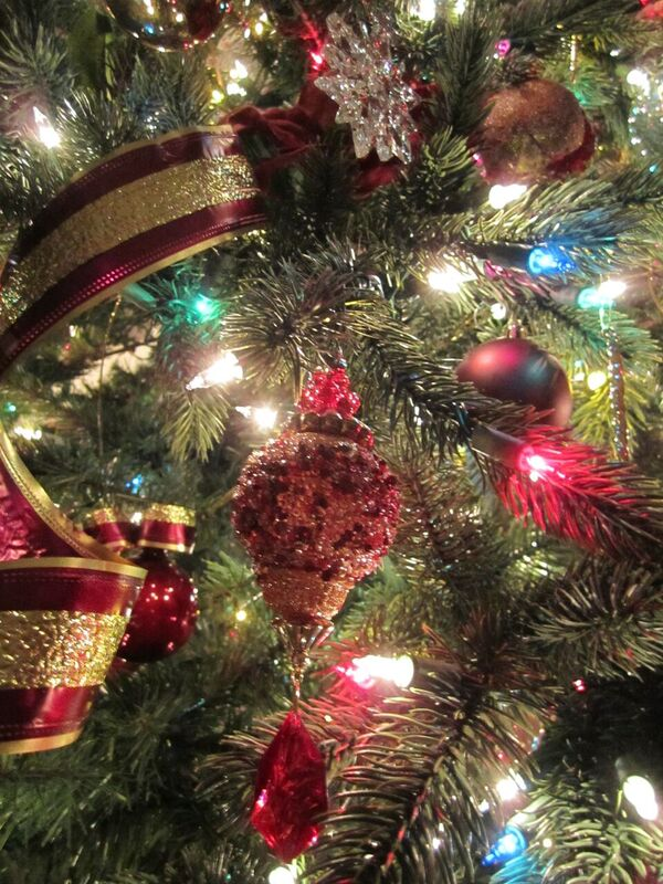 Christmas tree decorated with silver and burgundy ornaments