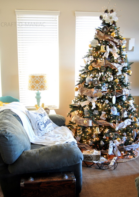 Decorated artificial Christmas tree in living room