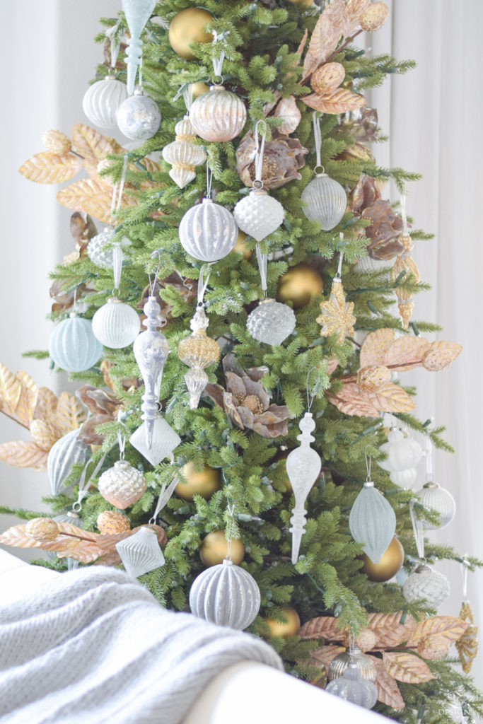 Closeup shot of an artificial Christmas tree decorated with assorted ornaments