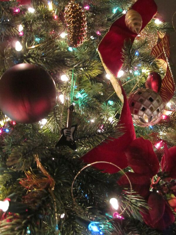Close-up of silver and burgundy ornaments on tree