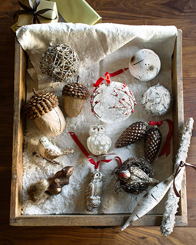Assorted rustic-style Christmas ornaments placed inside a box