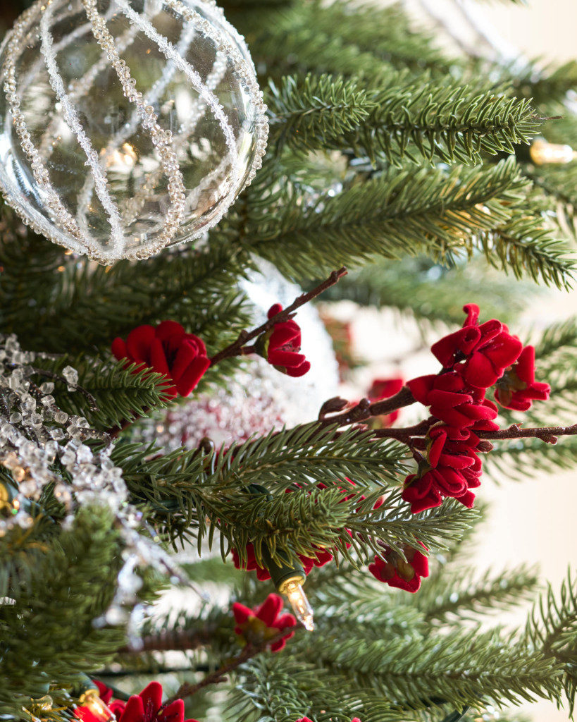 close up of christmas tree ball and picks