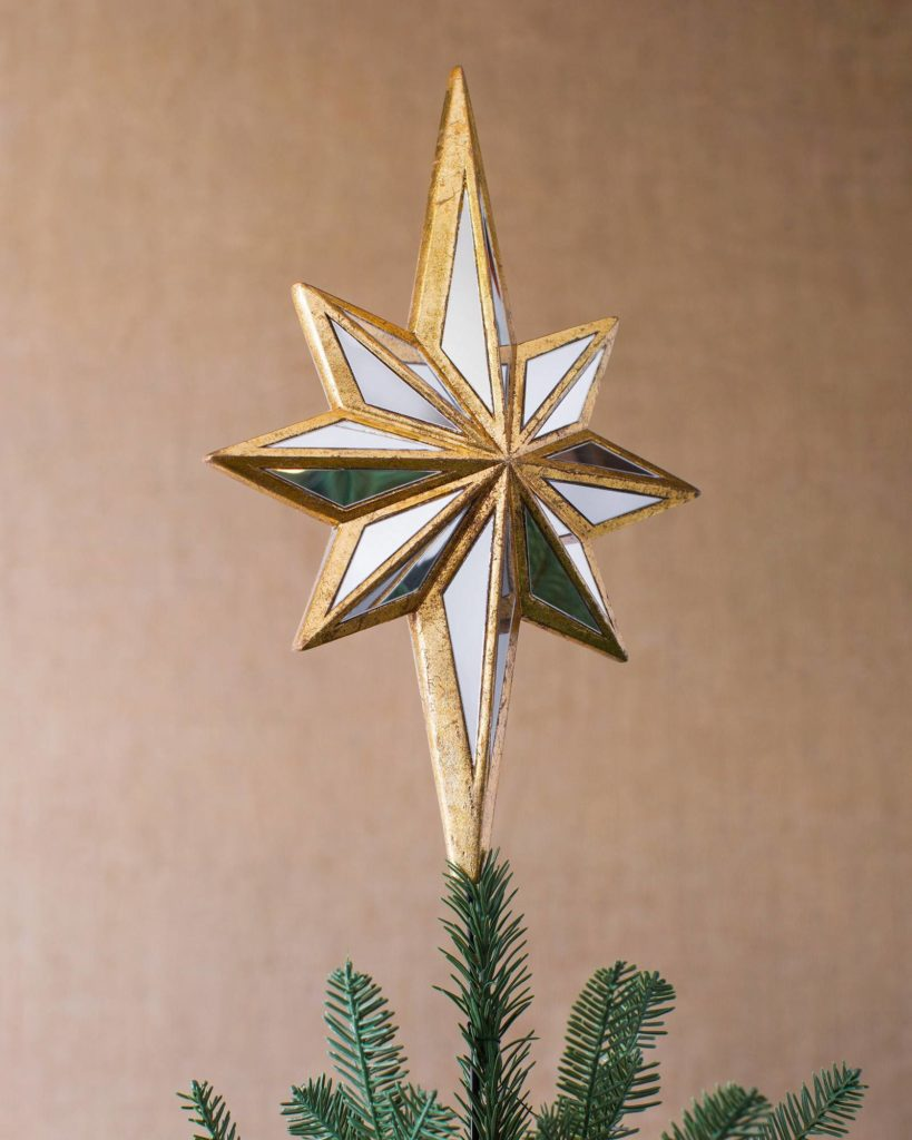 Balsam Hill Double Sided Mirrored Star Christmas Tree Topper on tan background
