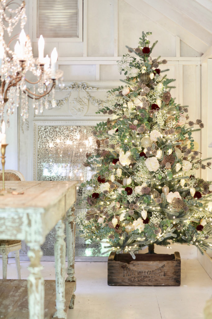 Summer Christmas tree decorated with pinecones and flowers in a French Country Cottage