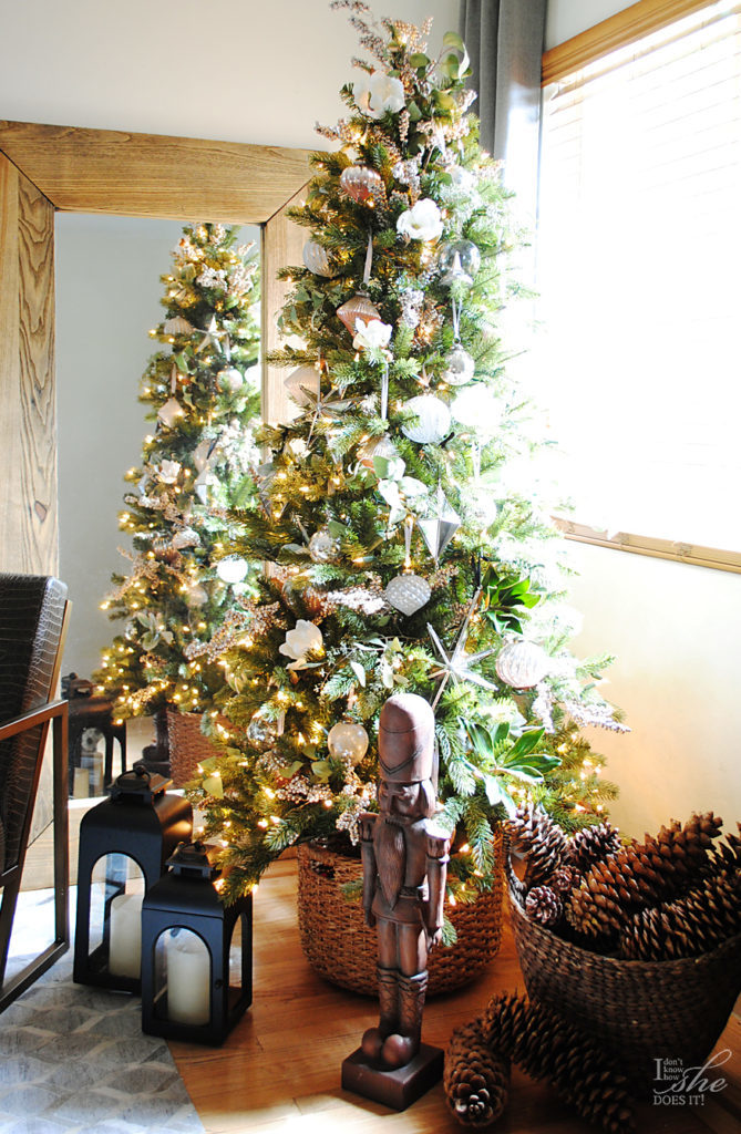 An artificial Christmas tree decorated with assorted ornaments