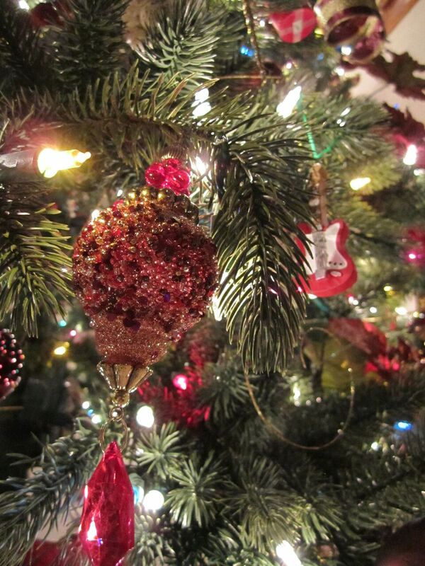Close-up of artificial Christmas tree decorate with silver and burgundy ornaments