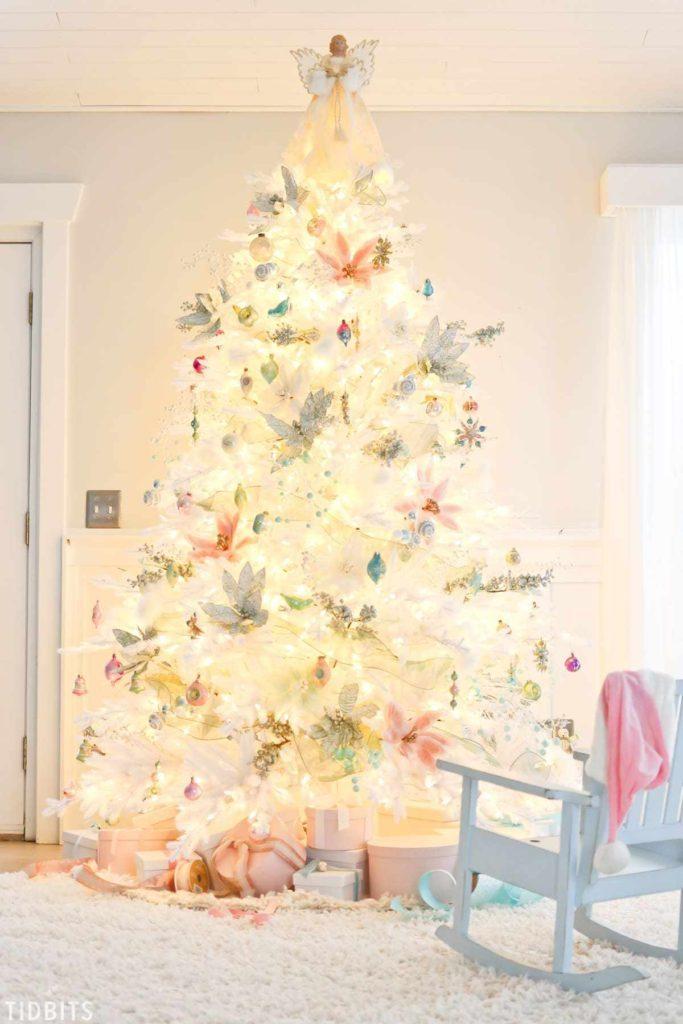 full shot of pre-lit white christmas tree