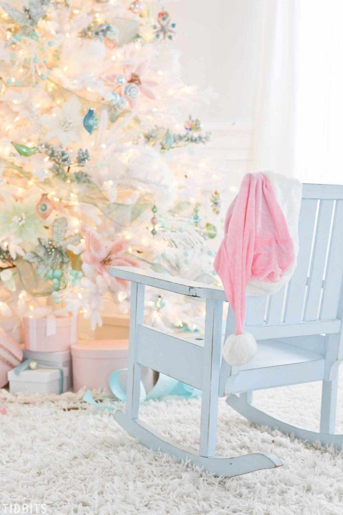 rocking chair beside pre-lit white christmas tree