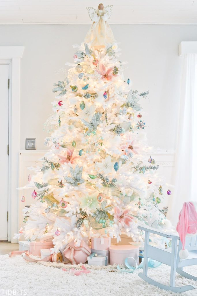 full shot of white christmas tree with pastel decor