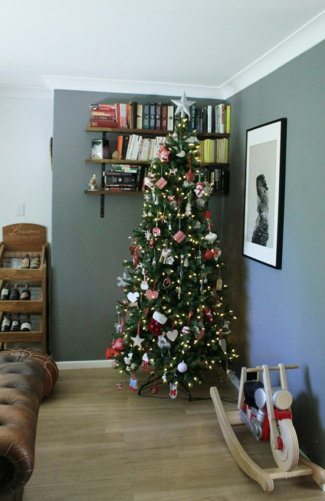Artificial Christmas tree decorated with whimsical red and white theme