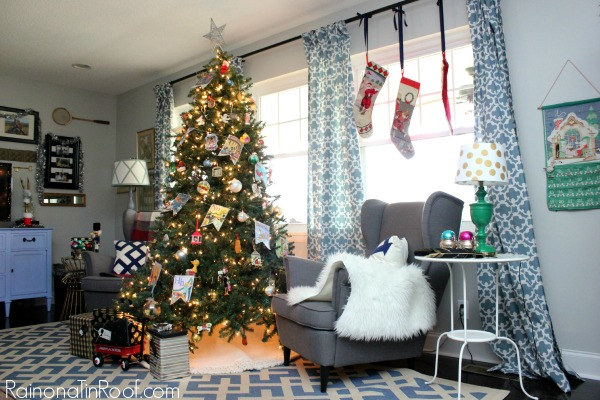 Wide shot of a living room with a decorated Christmas tree as the centerpiece.