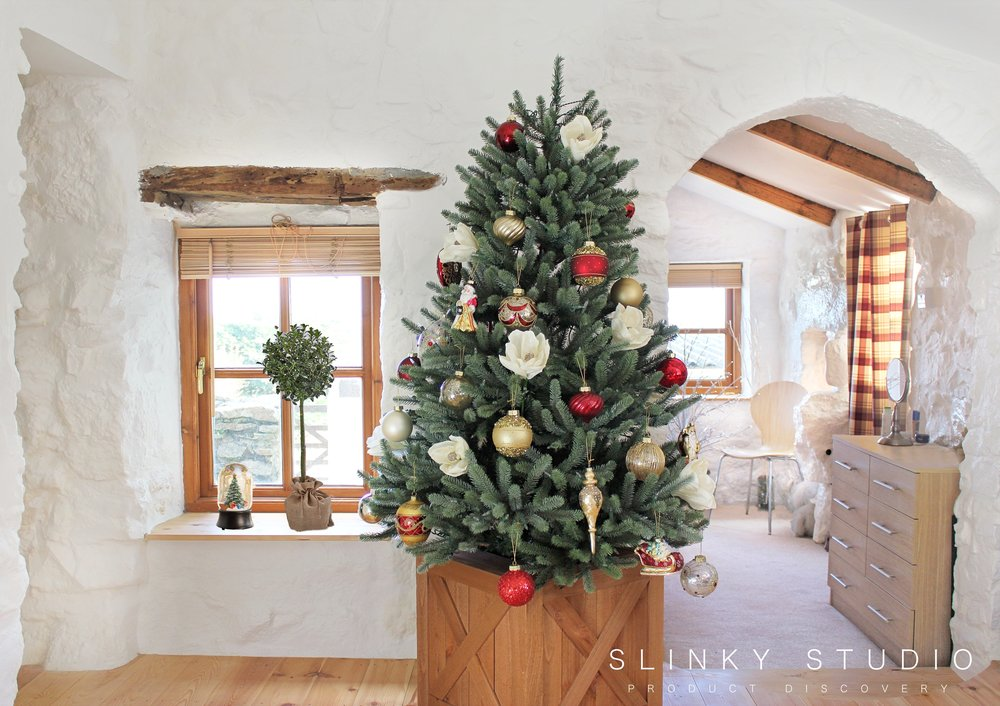Christmas tree decorated with white flowers and glass ornaments