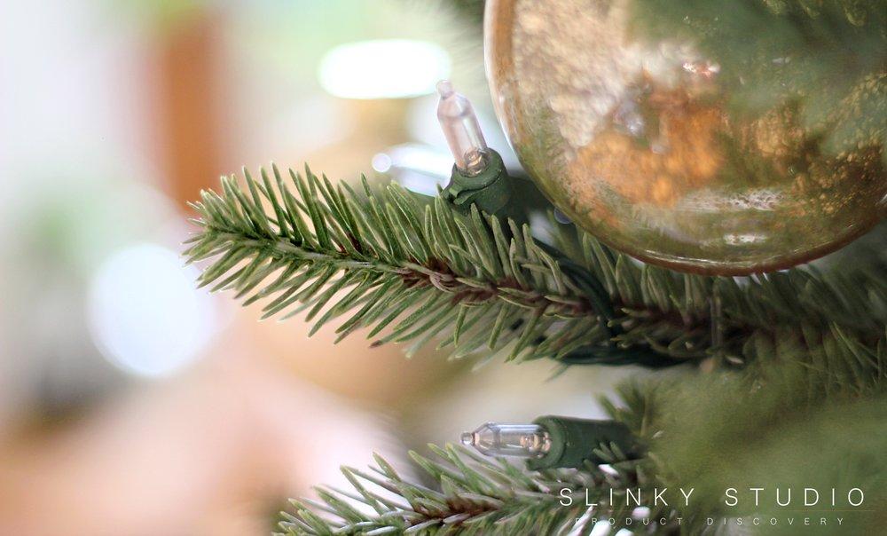 Close up of foliage and Christmas ball