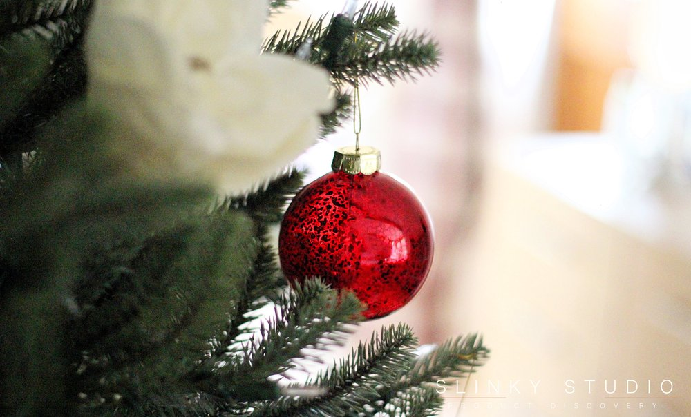 Close up of red ball ornament on tree